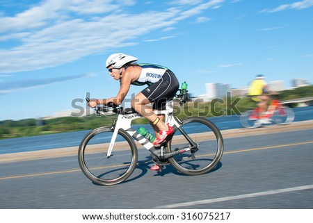 WASHINGTON - SEPTEMBER 13: An athlete cycles in the Nation's Triathlon on September 13, 2015 in Washington, D.C. - stock photo