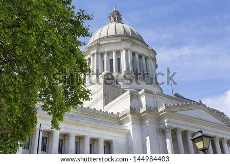 Washington State Capitol Building in Olympia Framed by Tree Foliage - stock photo