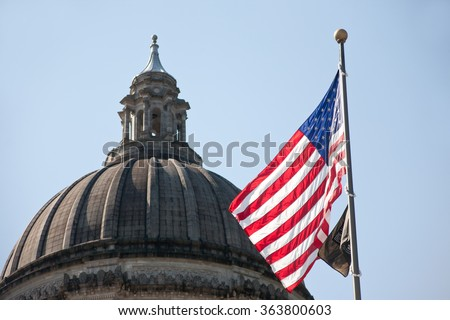 Washington State Capitol, Legislative building's dome with the flag of the United States - stock photo