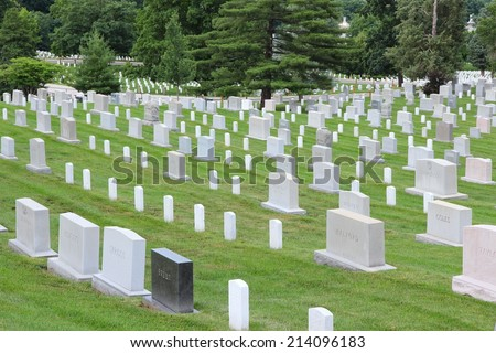 WASHINGTON, USA - JUNE 13, 2013: Arlington National Cemetery in Washington. Arlington National Cemetery was established in 1864 and has more than 400,000 graves. - stock photo