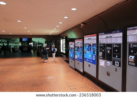 WASHINGTON, USA - JUNE 14, 2013: People walk into metro station in Washington. With 212 million annual rides in 2012 Washington Metro is the 3rd busiest rapid transit system in the USA. - stock photo