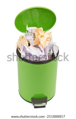 Waste can full up with crumpled paper. Isolated on white background - stock photo