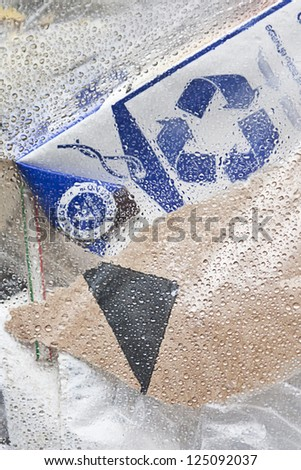 waste in bag plastic and recycling symbol - stock photo