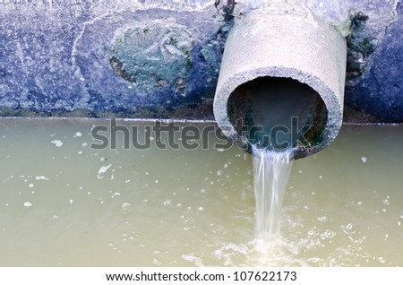 Waste pipe or drainage polluting environment - stock photo