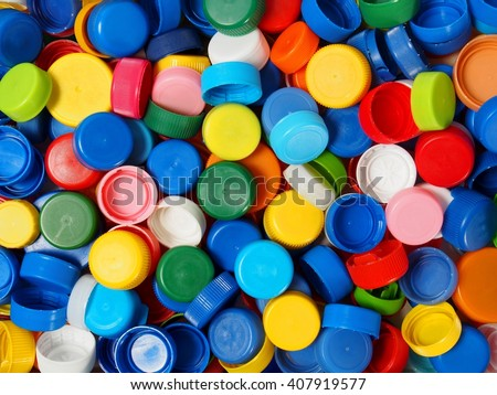 Waste plastic bottle caps ready for recycling - stock photo