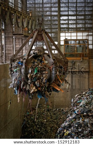 Waste processing plant interior with garbage - stock photo