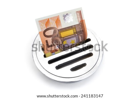 Wasted money.  --  A fifty euro note thrown through a drain. - stock photo
