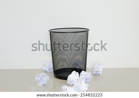 wastepaper out the recycle bin on the floor - stock photo