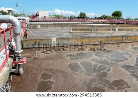 Wastewater treatment plant aerating basin - stock photo