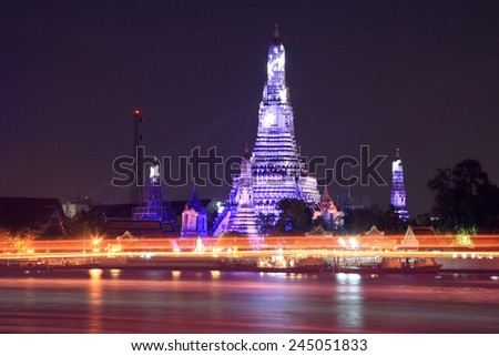 Wat Arun and light trail at Twilight Time in Bangkok, Thailand - stock photo