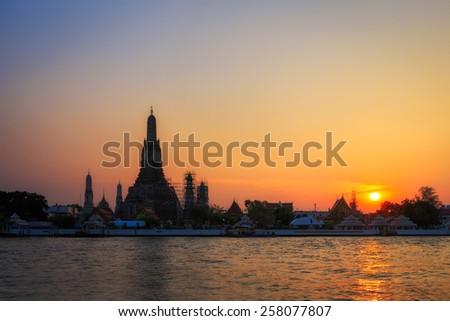 Wat Arun at  sunset in Bangkok, Thailand - stock photo