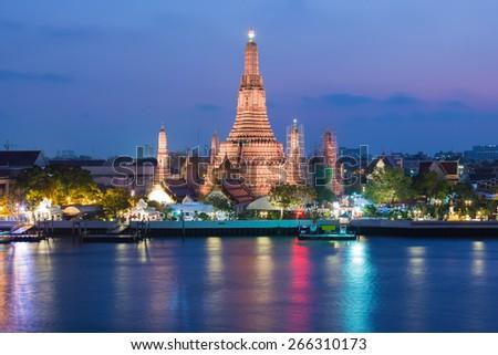 Wat Arun Buddhist religious landmark of Thailand at twilight time - stock photo