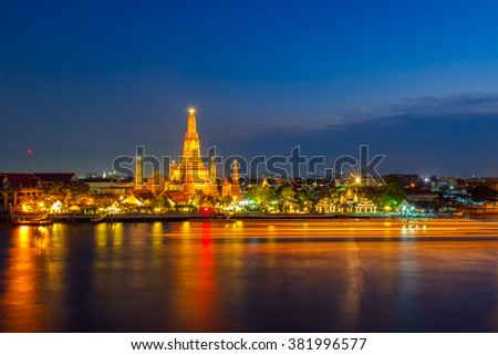 Wat Arun Buddhist religious places in night time, Bangkok, Thailand - stock photo