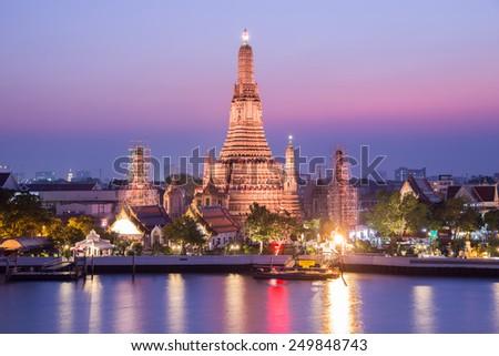 Wat Arun Buddhist religious places in twilight time, Bangkok, Thailand - stock photo