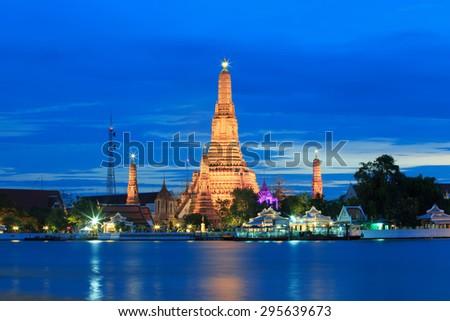 Wat Arun Ratchawararam Ratchawaramahawihan or Wat Arun or Temple of Dawn at dusk in Bangkok, Thailand. - stock photo