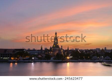 Wat Arun sunset light reflection pool in Bangkok Thailand. - stock photo