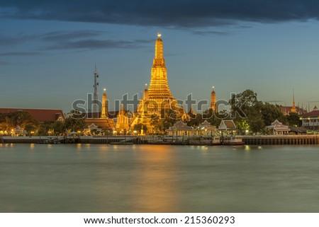 Wat Arun, The Temple of Dawn, at twilight, view across river. Bangkok, Thailand - stock photo