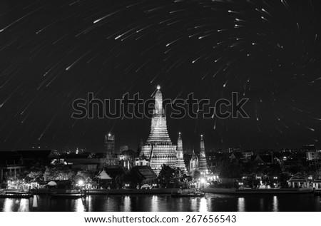 Wat Arun twilight reflection water and stars in Bangkok Thailand black and white tone. - stock photo