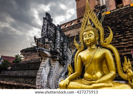 Wat Chedi Luang temple in Chiang Mai, Thailand (Deliberate high contrast in sky and slight low exposure for dramatic effect) - stock photo
