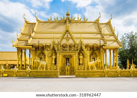 Wat paknam joelo architecture temple all gold color and blue sky at bangkla, chachoengsao, thailand - stock photo
