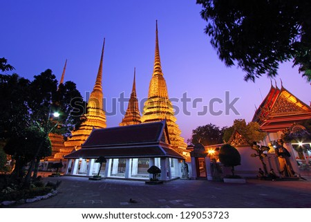 Wat Pho, Bangkok, Thailand. Also known as Wat Phra Chetuphon, 'Wat' means temple in Thai. The temple is one of Bangkok's most famous tourist sites. The temple has it's origins dating back to 1788. - stock photo