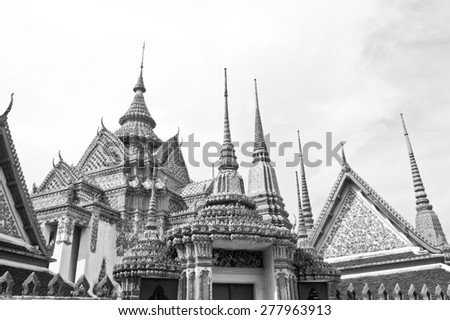 Wat Pho or Wat Phra Chetuphon, the Temple of the Reclining Buddha monochrome. In Thailand public domain or treasure of Buddhism. no copyright, no name of artist appear. - stock photo