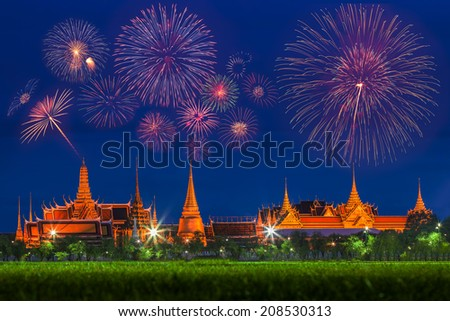 Wat Phra Kaew with fireworks (Grand Palace of Bangkok.) View from the Sanam Luang at twilight. - stock photo