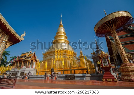 WAT PHRATHAT HARIPHUNCHAI TEMPLE LAMPOON PROVINCEES IN THAILAND - stock photo