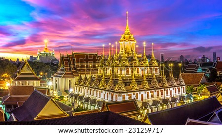 Wat Ratchanaddaram and Loha Prasat Metal Castle at Dusk (Bangkok ,Thailand) - stock photo