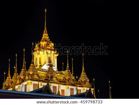 Wat Ratchanatdaram Temple at night, Bangkok, Thailand. Temple was submitted to UNESCO for consideration as a future World Heritage Site. - stock photo