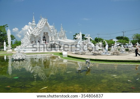 Wat Rong Khunis a contemporary, unconventional, privately owned, art exhibit in the style of aBuddhist templeinChiang Rai Province,Thailand. It is owned byChalermchai Kositpipat - stock photo