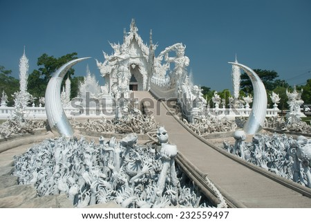 Wat Rong khun is known among foreigners as the White Temple in Chiangrai province Thailand - stock photo