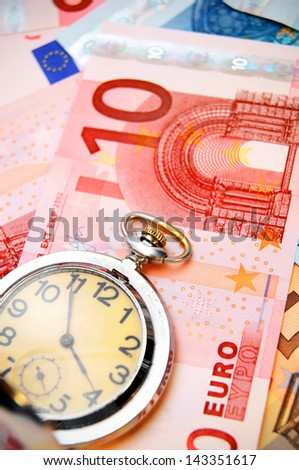 Watch and banknote euro. - stock photo