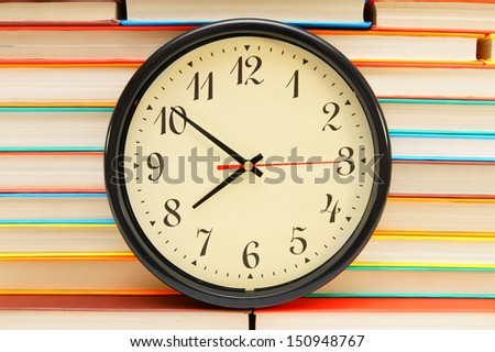 Watch and piles of books. - stock photo