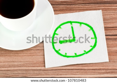 Watch on a napkin and cup of coffee - stock photo