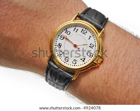 Watch on wrist against white. Includes clipping paths. - stock photo