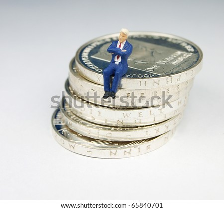 Watch over money - stock photo