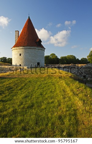 Watch tower in the grounds of Kuressaare Episcopal Castle or the Bishop castle on Saaremaa island in Estonia in Eastern Europe - stock photo