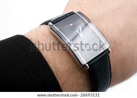 watch with four diamonds and leather belt on man's hand - stock photo