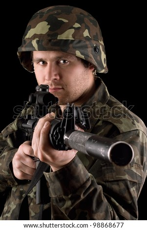 Watchful soldier aiming  m16 in studio. Isolated - stock photo