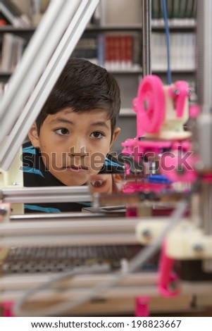 Watching the 3D printer. - stock photo