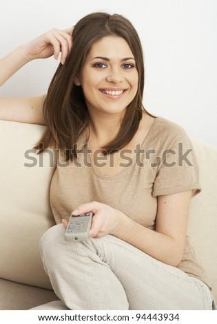 Watching tv portrait of woman - stock photo