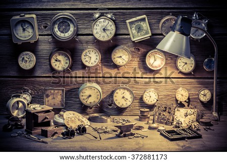 Watchmaker's workshop with clocks to repair - stock photo