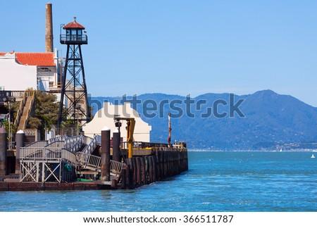 Watchtower and embankment of Alcatraz prison - stock photo