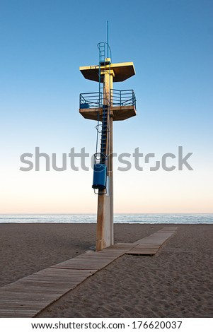 watchtower on a beach  - stock photo