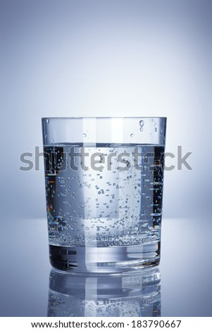 water and bubbles on a reflective background - stock photo