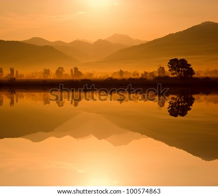 Water and mountains in the morning. - stock photo