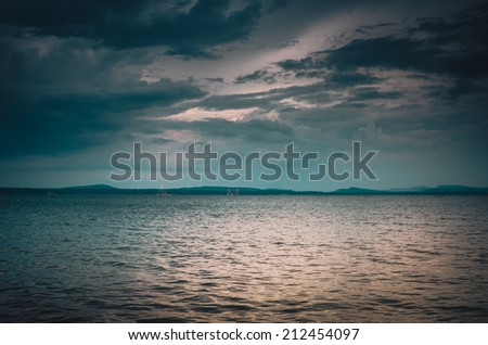 Water and sky in  the Reservoir embankment Sirinthorn Ubonratchatani Thailand vintage - stock photo