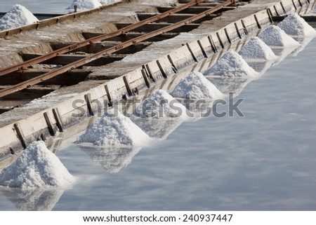 Water avaporation  pool at salinas producing salt - stock photo