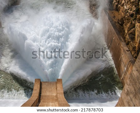 Water being released from a Dam - stock photo